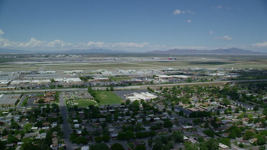 6K stock footage aerial video of approaching Salt Lake City International Airport, Utah Aerial Stock Footage | AX140_262