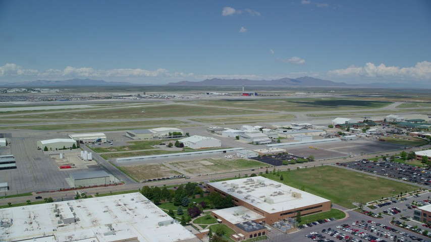Flying by the Salt Lake City International Airport, Utah Aerial Stock Footage | AX140_264