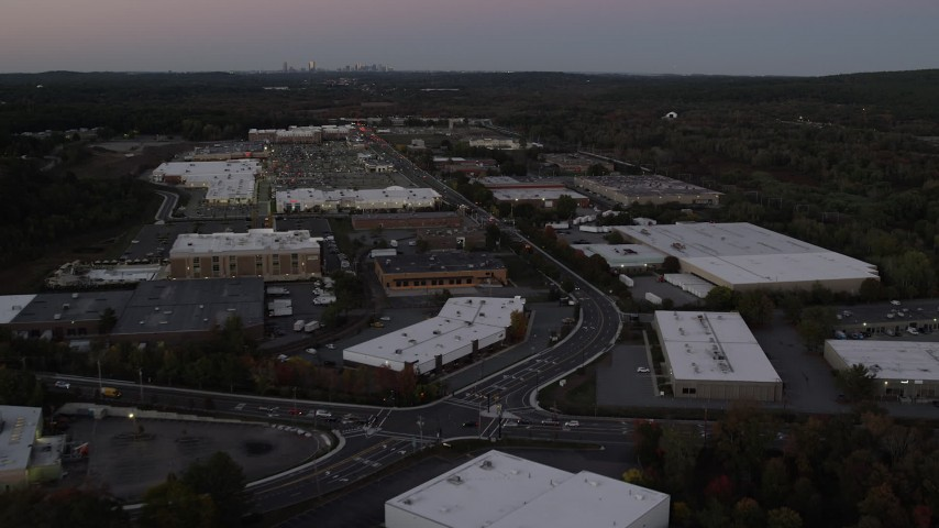 6K stock footage aerial video of a strip mall, warehouse buildings, University Avenue, Westwood, Massachusetts, twilight Aerial Stock Footage | AX141_001