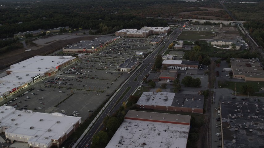 6K stock footage aerial video flying by a strip mall, panning left, Westwood, Massachusetts, twilight Aerial Stock Footage | AX141_002