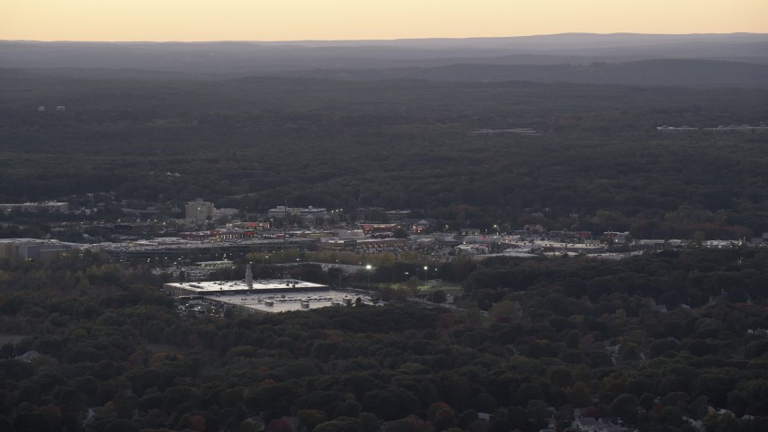 6K stock footage aerial video flying by shopping center, trees, Dedham, Massachusetts, twilight Aerial Stock Footage | AX141_004