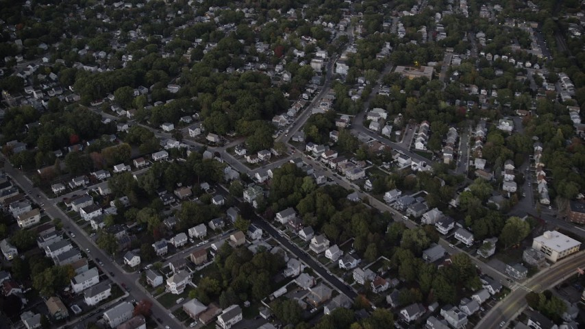 6K stock footage aerial video flying over a suburban neighborhood, trees, Hyde Park, Massachusetts, twilight Aerial Stock Footage | AX141_005