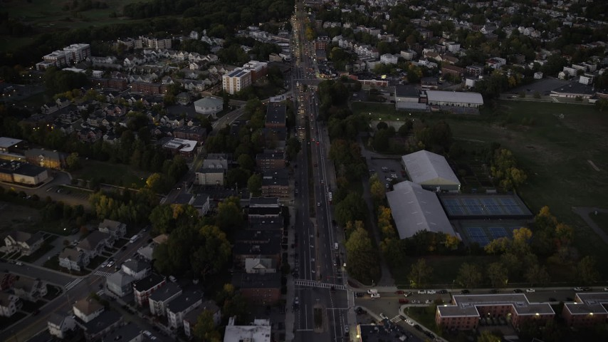 6K stock footage aerial video of Blue Hill Avenue, approach downtown skyline, Dorchester, Downtown Boston, Massachusetts, autumn, twilight Aerial Stock Footage | AX141_008