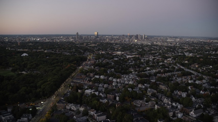 6K stock footage aerial video flying over suburban neighborhood, Dorchester, approach Downtown Boston, Massachusetts, twilight Aerial Stock Footage | AX141_009