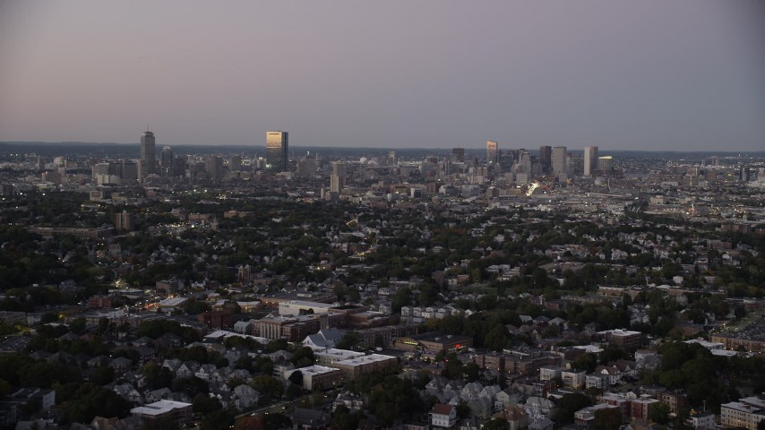 6K stock footage aerial video approaching the skyline, Downtown Boston, Massachusetts, twilight Aerial Stock Footage | AX141_010