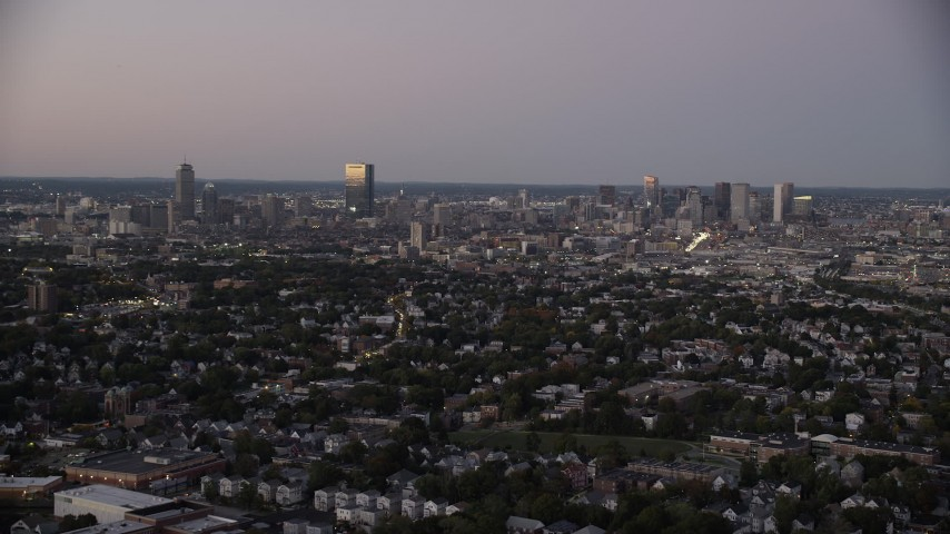 6K stock footage aerial video flying by the downtown skyline, Downtown Boston, Massachusetts, twilight Aerial Stock Footage | AX141_011