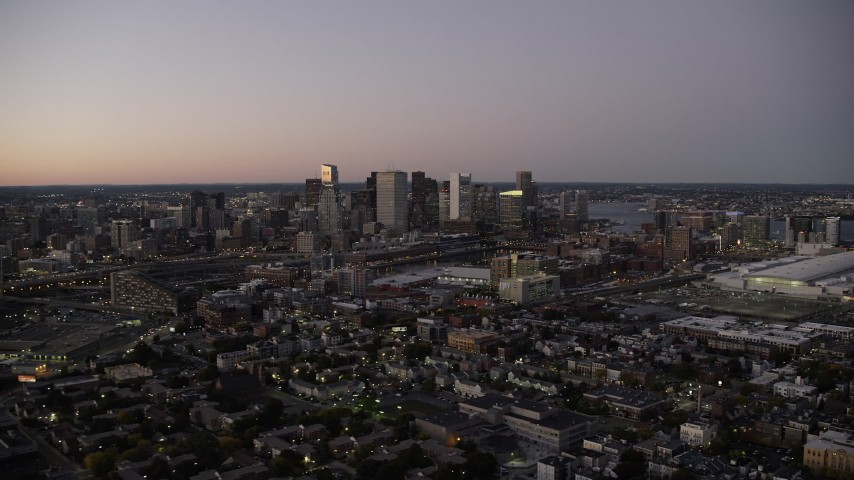 6K stock footage aerial video flying by buildings city streets, downtown skyline, Boston, Massachusetts, twilight Aerial Stock Footage | AX141_017