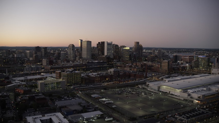6K stock footage aerial video flying by Boston Convention and Exhibition Center, downtown skyline, Boston, Massachusetts, twilight Aerial Stock Footage | AX141_018