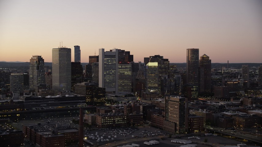 6K stock footage aerial video flying by buildings, skyscrapers, Downtown Boston skyline, Massachusetts, twilight Aerial Stock Footage | AX141_019
