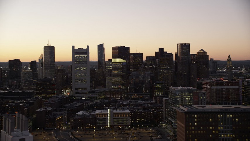 6K stock footage aerial video flying by buildings, city streets, skyline, Downtown Boston, Massachusetts, twilight Aerial Stock Footage | AX141_020