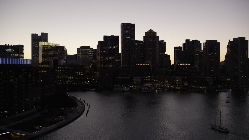 6K stock footage aerial video approaching skyline from Rowes Wharf, Downtown Boston, Massachusetts, twilight Aerial Stock Footage | AX141_024