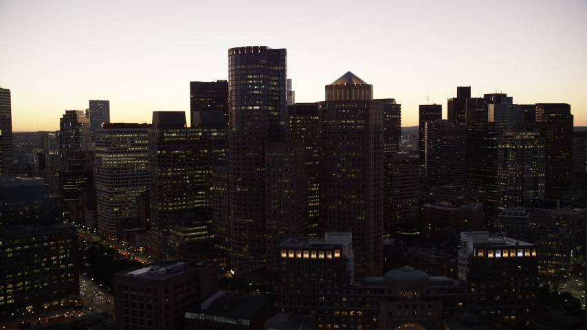 6K stock footage aerial video approaching Two International Place, skyline, Downtown Boston, Massachusetts, twilight Aerial Stock Footage | AX141_025