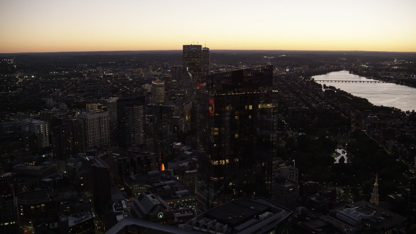 6K stock footage aerial video flying by Millennium Tower, Downtown Boston, Back Bay, Massachusetts, twilight Aerial Stock Footage | AX141_028