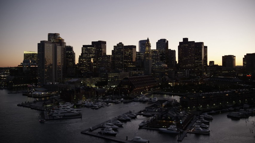 6K stock footage aerial video orbiting waterfront skyline, Downtown Boston, Massachusetts, twilight Aerial Stock Footage | AX141_031