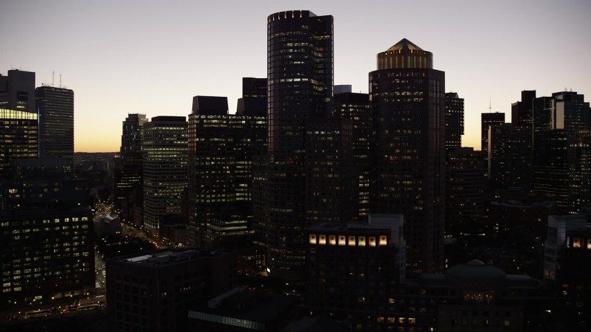 6K stock footage aerial video of One International Place, Two International Place, Downtown Boston, Massachusetts, twilight Aerial Stock Footage | AX141_034
