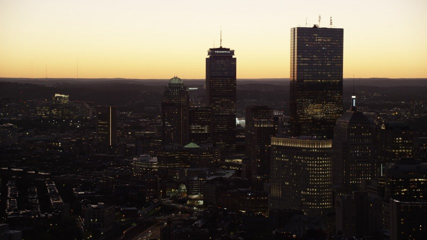 6K stock footage aerial video flying by 111 Huntington Avenue, Prudential Tower, 200 Clarendon, Downtown Boston, Massachusetts, twilight Aerial Stock Footage | AX141_037