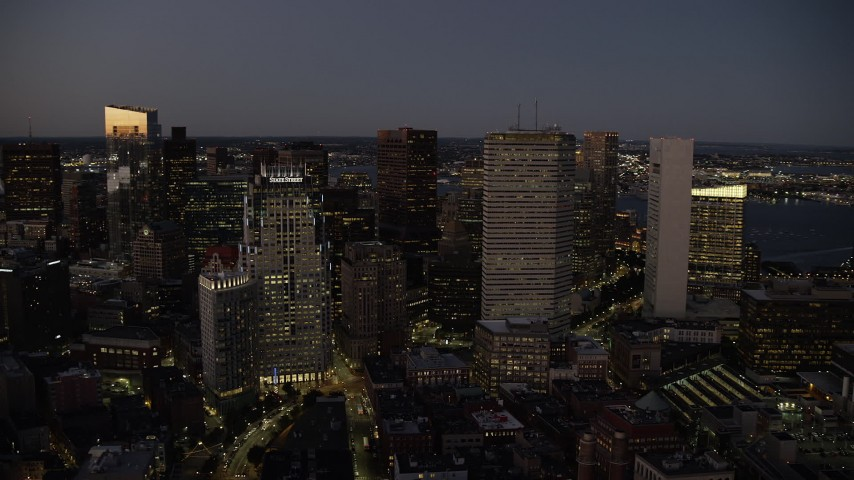6K stock footage aerial video flying by skyscrapers and buildings, Downtown Boston, Massachusetts, twilight Aerial Stock Footage | AX141_038