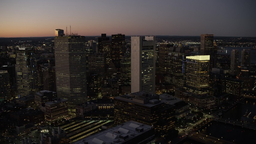 6K stock footage aerial video flying by skyscrapers, Downtown Boston, Massachusetts, twilight Aerial Stock Footage | AX141_039