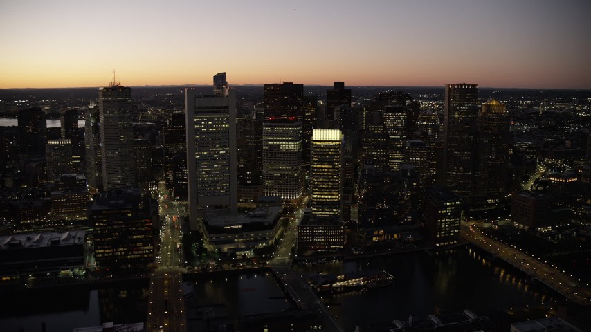 6K stock footage aerial video flying by skyscrapers, city streets, Downtown Boston, Massachusetts, twilight Aerial Stock Footage | AX141_040
