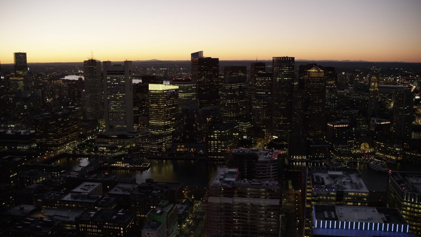 6K stock footage aerial video flying by the skyline, Downtown Boston, Massachusetts, twilight Aerial Stock Footage | AX141_041