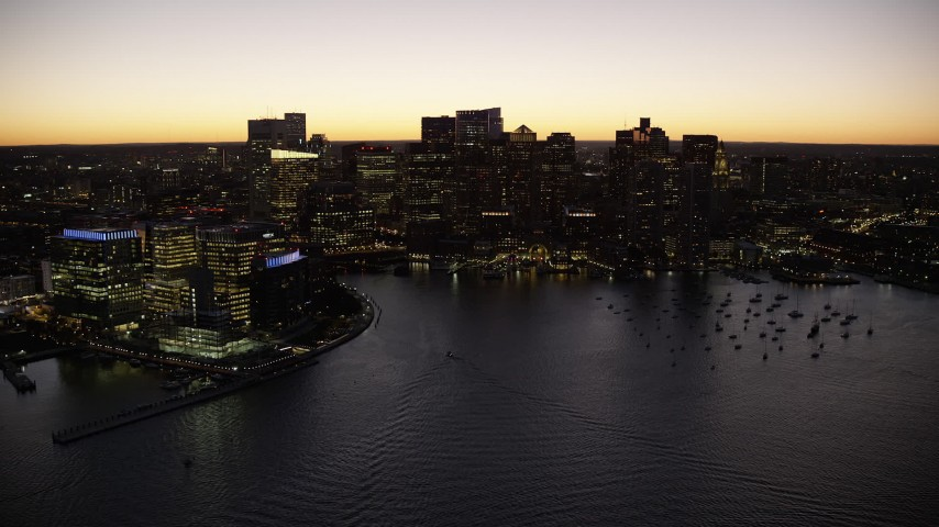 6K stock footage aerial video flying by skyline, harbor, Downtown Boston, Massachusetts, twilight Aerial Stock Footage | AX141_047