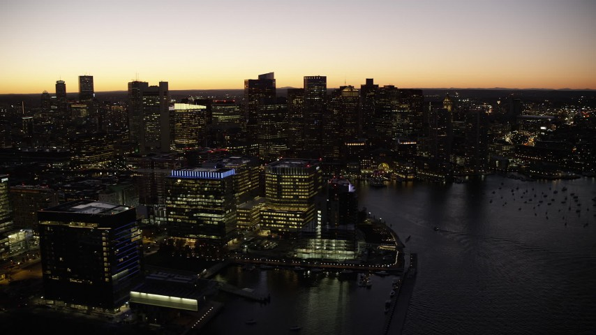 6K stock footage aerial video flying by skyline, tilt down to buildings, Downtown Boston, Massachusetts, twilight Aerial Stock Footage | AX141_048