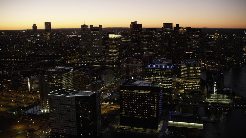 6K stock footage aerial video flying by skyline, office buildings, Downtown Boston, Massachusetts, twilight Aerial Stock Footage | AX141_049