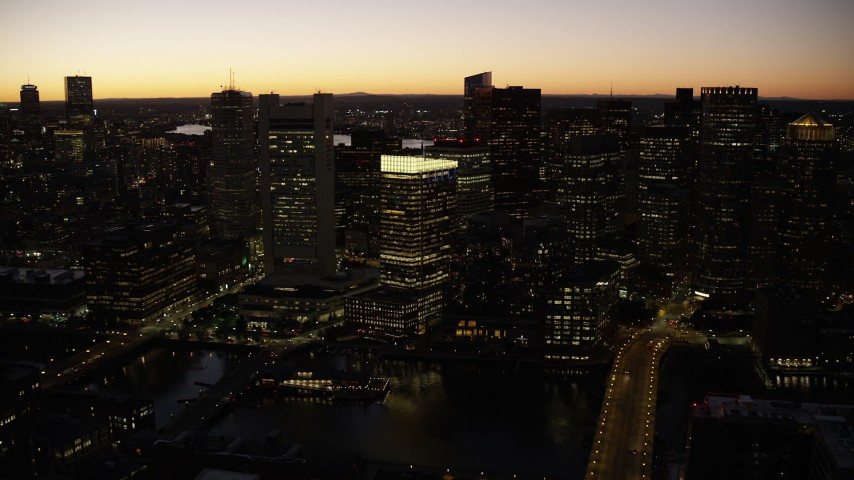 6K aerial video approaching Russia Wharf, skyscrapers, Downtown Boston, Massachusetts, twilight Aerial Stock Footage | AX141_052