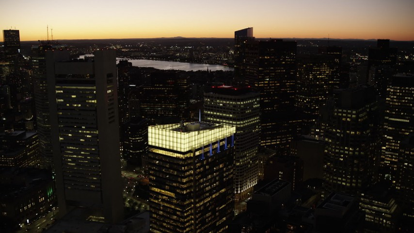 6K stock footage aerial video flying over skyscrapers, approach Russia Wharf, Downtown Boston, Massachusetts, twilight Aerial Stock Footage | AX141_053