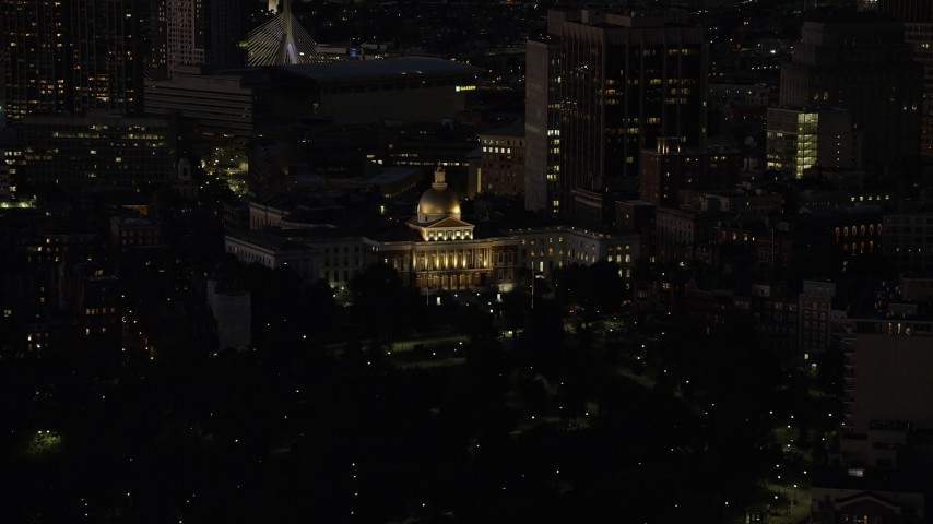 6K stock footage aerial video flying by the Massachusetts State House, Downtown Boston, Massachusetts, night Aerial Stock Footage | AX141_058