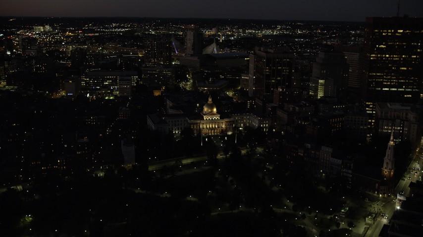 6K stock footage aerial video approaching Massachusetts State House, tilt down, Downtown Boston, Massachusetts, night Aerial Stock Footage | AX141_059
