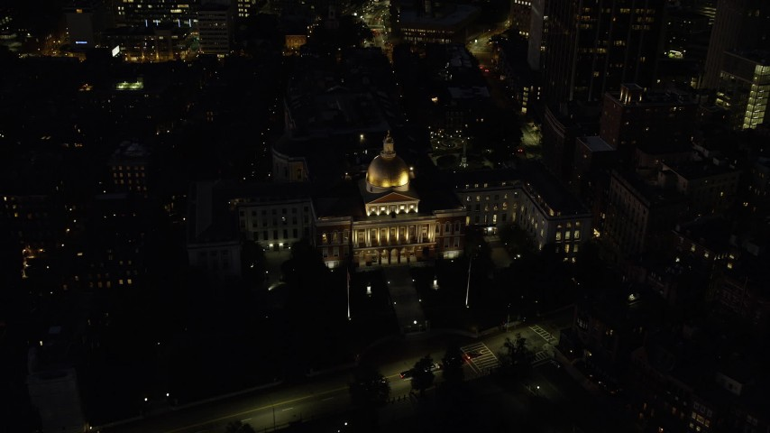 6K stock footage aerial video approaching and tilting down over Massachusetts State House, Downtown Boston, Massachusetts, night Aerial Stock Footage | AX141_060