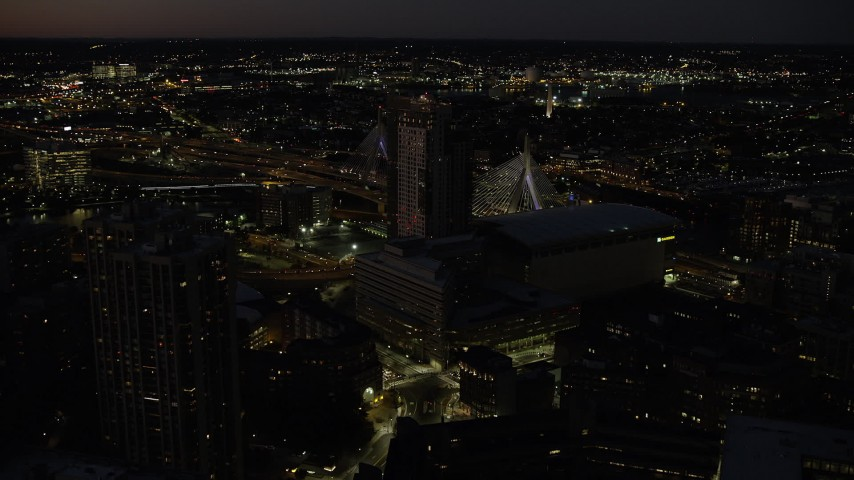 6K stock footage aerial video approaching Avalon North Station, TD Garden, Downtown Boston, Massachusetts, night Aerial Stock Footage | AX141_061