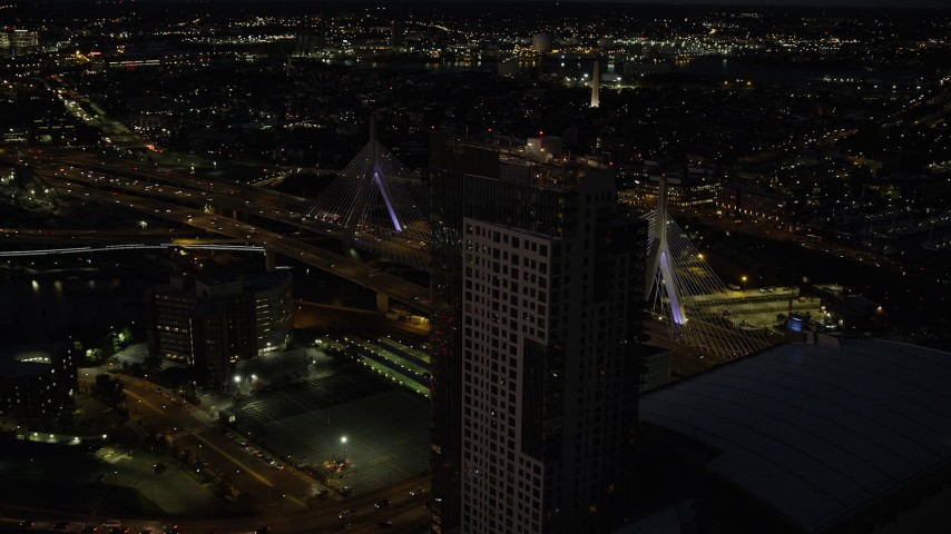 6K stock footage aerial video approaching Avalon North Station, Zakim Bridge, Boston, Massachusetts, night Aerial Stock Footage | AX141_062