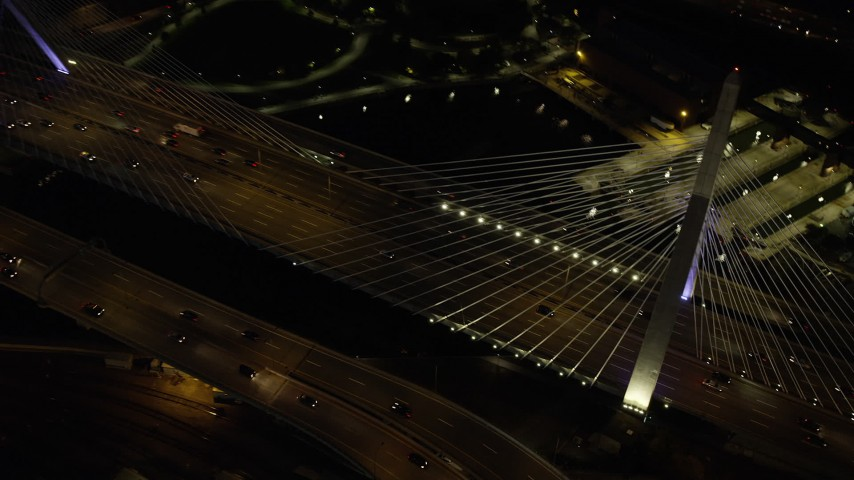 6K stock footage aerial video of a bird's eye view flying over Zakim Bridge, light traffic, Boston, Massachusetts, night Aerial Stock Footage | AX141_063