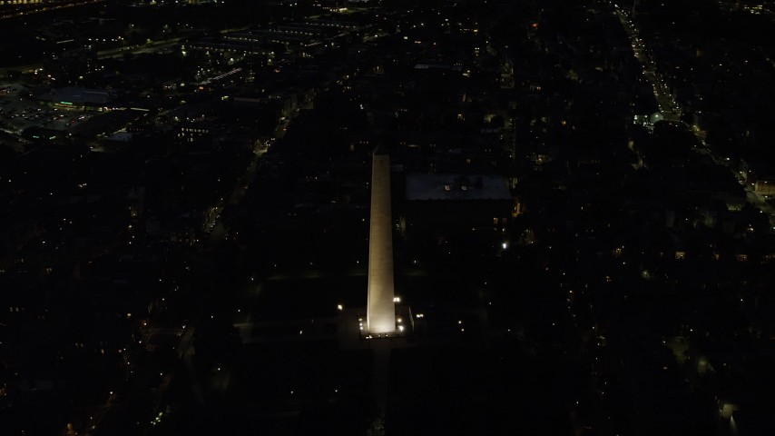 6K stock footage aerial video orbiting Bunker Hill Monument, Charlestown, Massachusetts, night Aerial Stock Footage | AX141_064