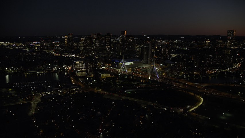6K stock footage aerial video flying by skyline, approaching Zakim Bridge, Downtown Boston, Massachusetts, night Aerial Stock Footage | AX141_066