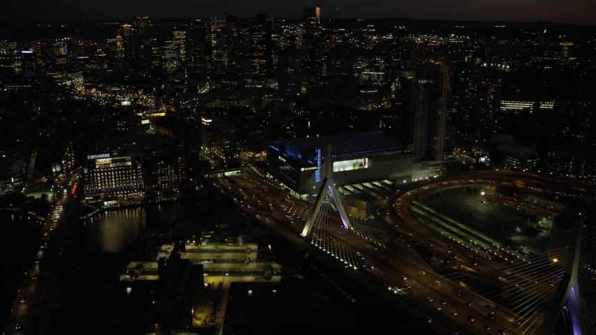 6K stock footage aerial video flying by Zakim Bridge, TD Garden, Downtown Boston, Massachusetts, night Aerial Stock Footage | AX141_067