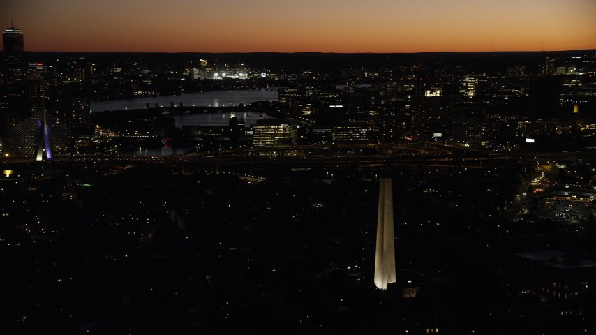 6K stock footage aerial video orbiting Bunker Hill Monument, Zakim Bridge, Charlestown, Massachusetts, twilight Aerial Stock Footage | AX141_070