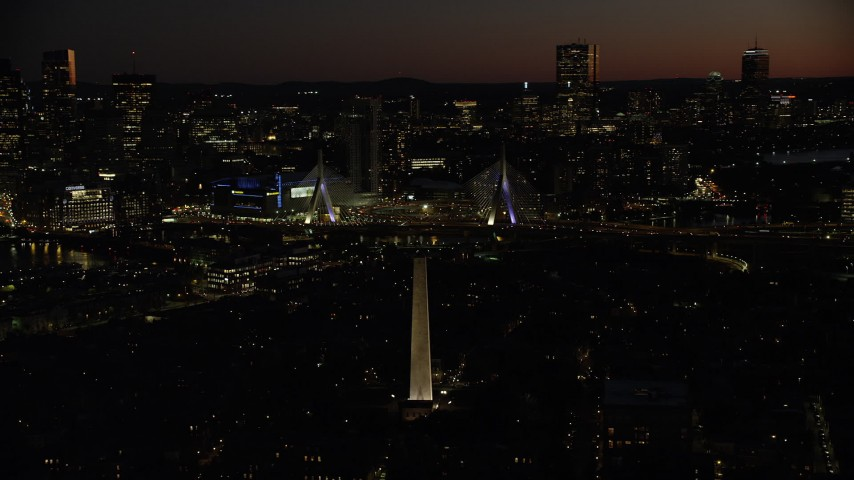 6K stock footage aerial video orbiting Bunker Hill Monument, Zakim Bridge, downtown skyline, Charlestown, Massachusetts, night Aerial Stock Footage | AX141_071