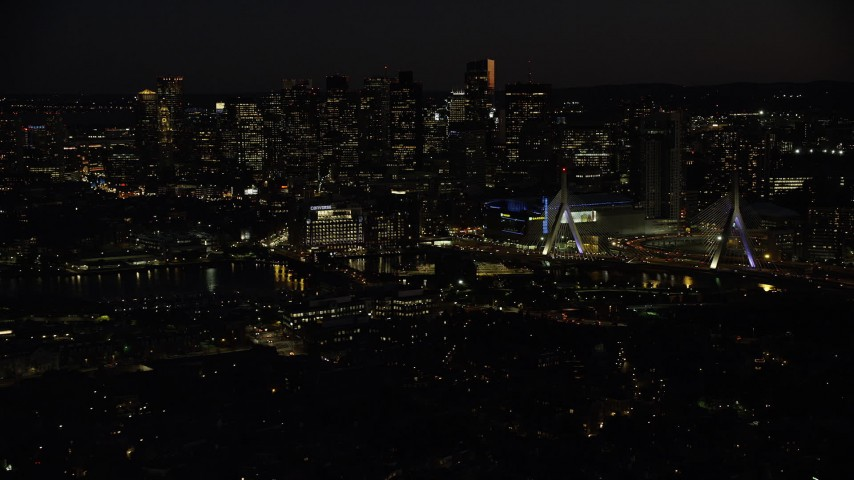 6K stock footage aerial video approaching Zakim Bridge, TD Garden, Downtown Boston, Massachusetts, night Aerial Stock Footage | AX141_072