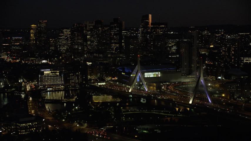 6K stock footage aerial video approaching Zakim Bridge, TD Garden, Avalon North Station, Downtown Boston, Massachusetts, night Aerial Stock Footage   AX141_073