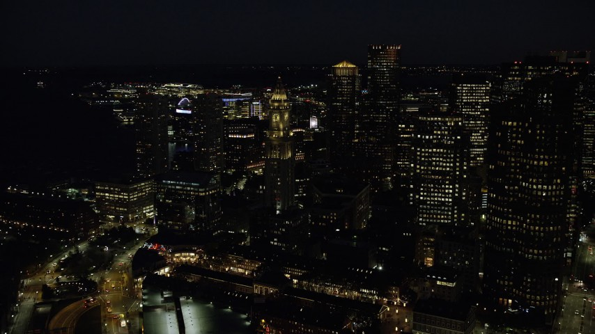 6K stock footage aerial video flying by Custom House Tower, Downtown Boston, Massachusetts, night Aerial Stock Footage | AX141_076