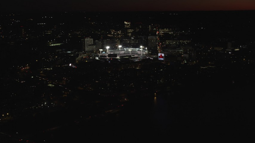 6K stock footage aerial video flying by baseball game in progress at Fenway Park, Boston, Massachusetts, night Aerial Stock Footage | AX141_084