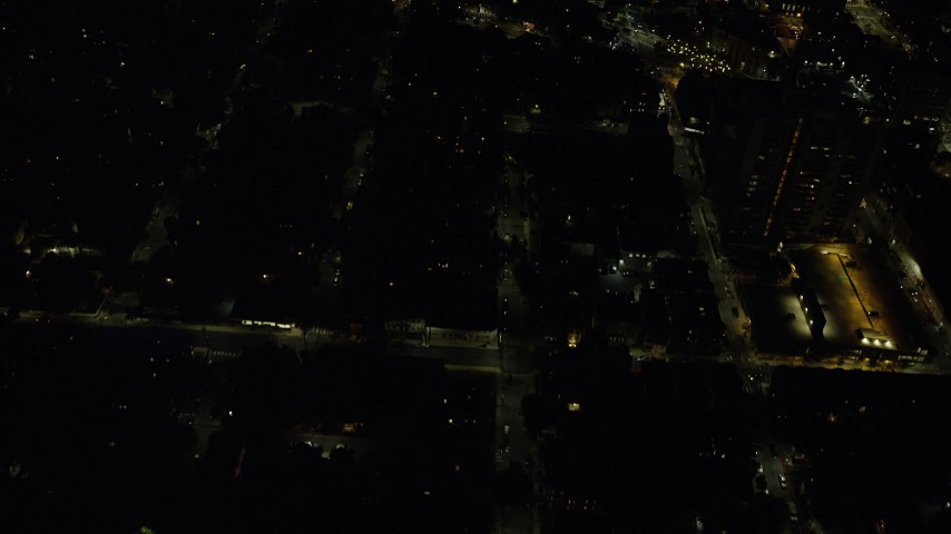 6K stock footage aerial video of a bird's eye view flying over apartment buildings, city streets, Cambridge, Massachusetts, night Aerial Stock Footage | AX141_087