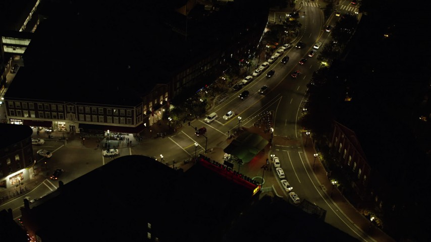 6K stock footage aerial video of a bird's eye view over Harvard Square, intersection, Harvard University, Massachusetts, night Aerial Stock Footage | AX141_091