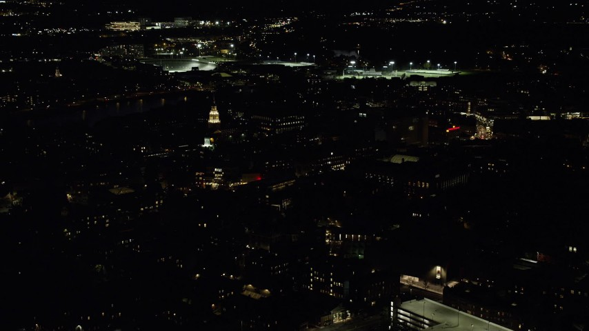 6K stock footage aerial video flying by the campus of Harvard University, Massachusetts, night Aerial Stock Footage | AX141_100