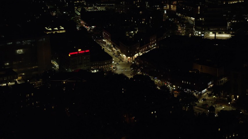 6K stock footage aerial video approaching Harvard Square, Massachusetts Avenue, Harvard University, Massachusetts, night Aerial Stock Footage | AX141_102