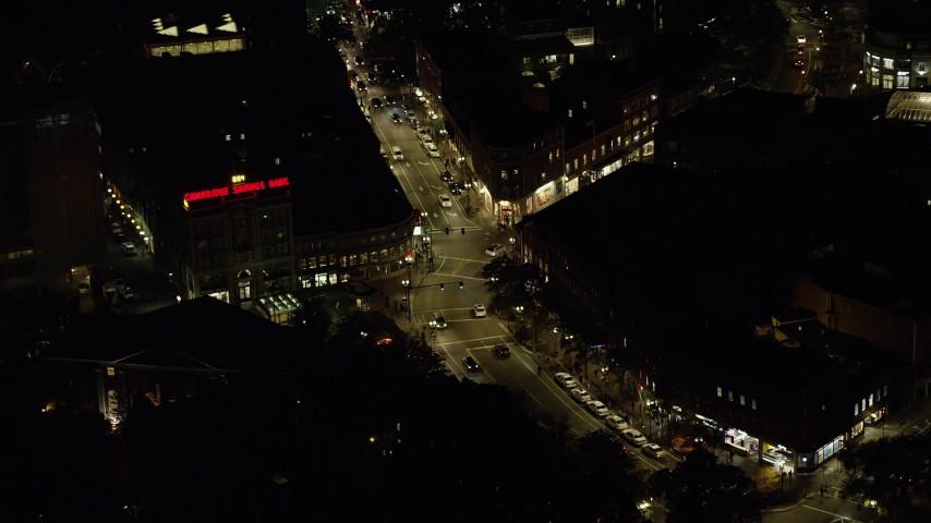 6K aerial video approaching, tilting down over Harvard Square, Harvard University, Massachusetts, night Aerial Stock Footage | AX141_103