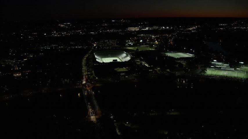 6K stock footage aerial video approaching Harvard Stadium, tilt down, Harvard University, Massachusetts, night Aerial Stock Footage | AX141_105